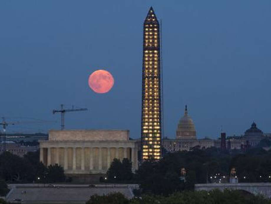 A harvest moon rises over landmarks in D.C. Time is limited for Congress to reach a budget deal to avert another shutdown in January. Photo: Getty Images / 2013 NASA
