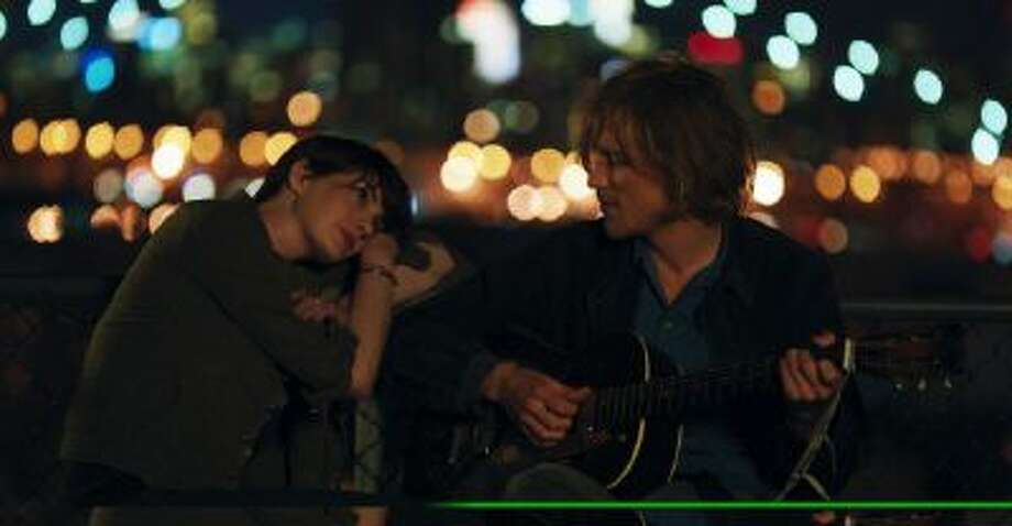 """This photo provided by the Sundance Institute shows Anne Hathaway, left, and Johnny Flynn in a scene from the film, """"Song One,"""" directed by Kate Barker-Froyland."""
