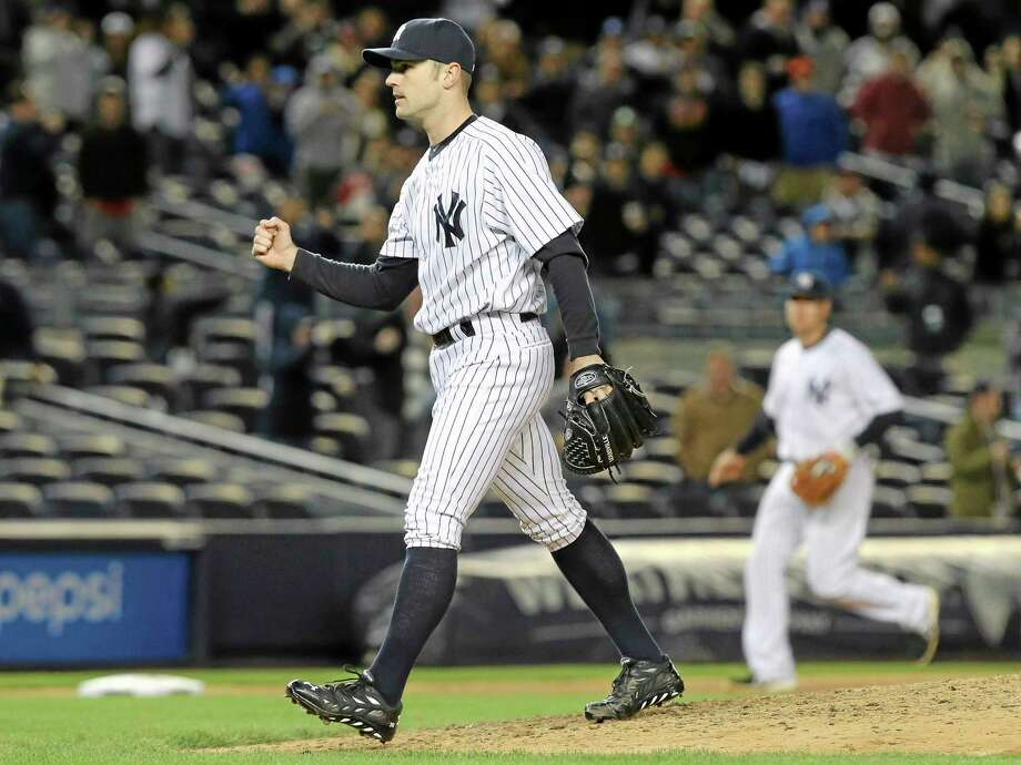 New York Yankees relief pitcher David Robertson pumps his fist after striking out Los Angeles Angels designated hitter Raul Ibanez in the ninth inning their baseball game at Yankee Stadium, Sunday in New York. The Yankee won 3-2. (AP Photo/John Minchillo) Photo: AP / FR170537 AP