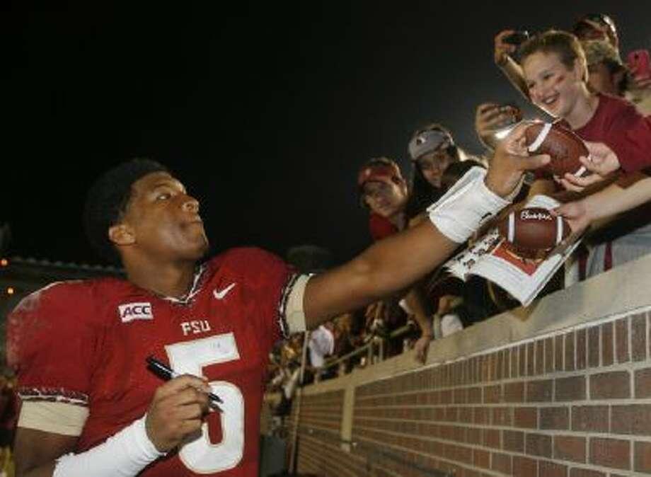 Florida State quarterback Jameis Winston (5) will remain active for the No. 1 Seminoles.