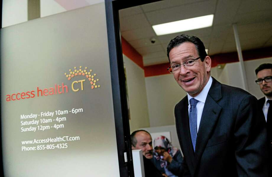 Connecticut Gov. Dannel P. Malloy leaves a grand opening for Connecticut's health insurance exchange's first insurance store, Access Health CT, Thursday, Nov. 7, 2013, in New Britain, Conn.  The site, where people can visit to sign up for coverage, is the first in the nation. (AP Photo/Jessica Hill) Photo: AP / FR125654 AP