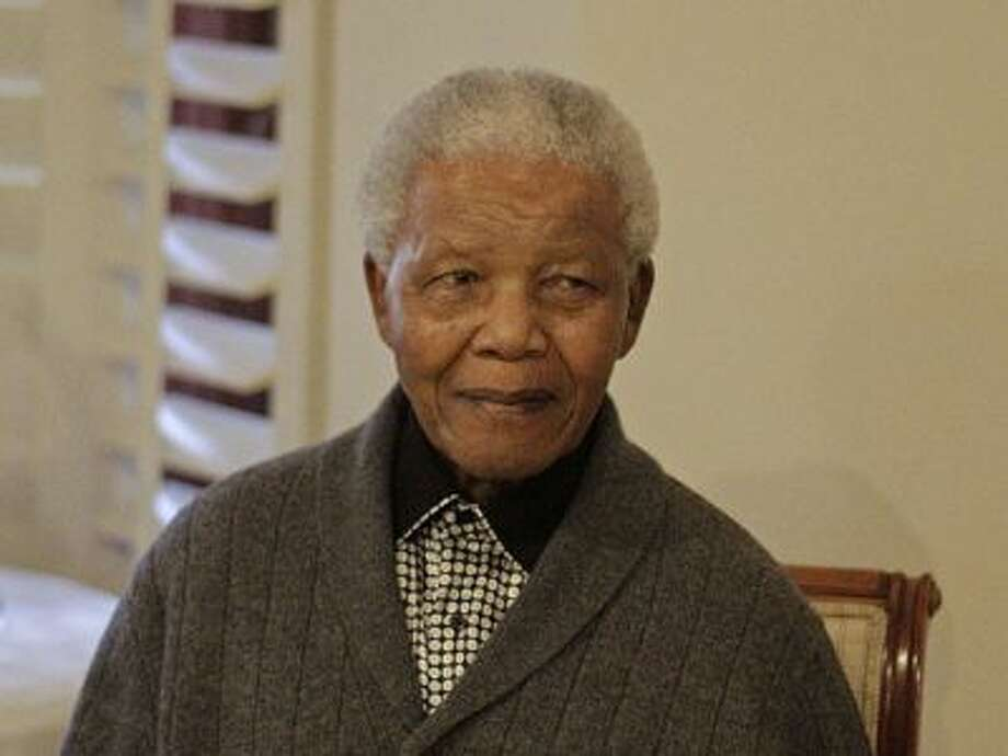 In this Wednesday, July 18, 2012 file photo, former South African President Nelson Mandela as he celebrates his birthday with family in Qunu, South Africa. South African. Photo: AP / AP2012
