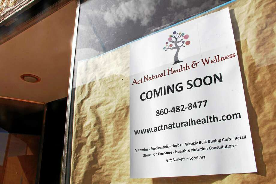 A sign outside the building where Act Natural Health and Wellness is expected to open next month at 24 Water St. in Torrington. The business owner said the shop will sell healthcare and dietary supplements like vitamins, essential oils, herbal remedies and skin care products. Photo: Esteban L. Hernandez — Register Citizen