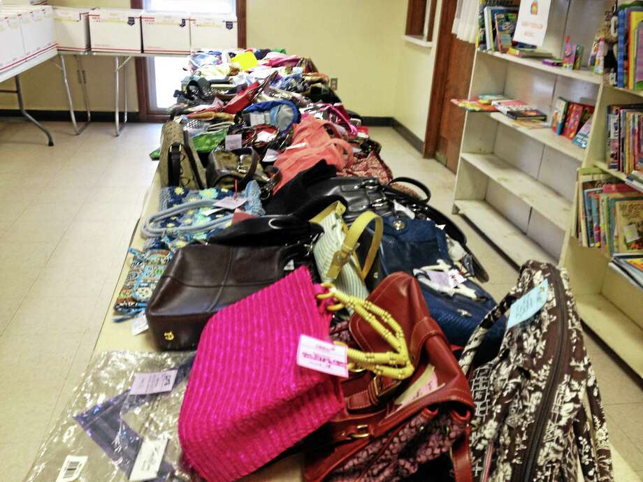 The donated purses, some new with tags, some gently used, for sale at the Tots Consignment sale in March at United Congregational Church, 1622 Torringford St., to benefit the One Town, One Book program. Photo: Jenny Golfin — Register Citizen