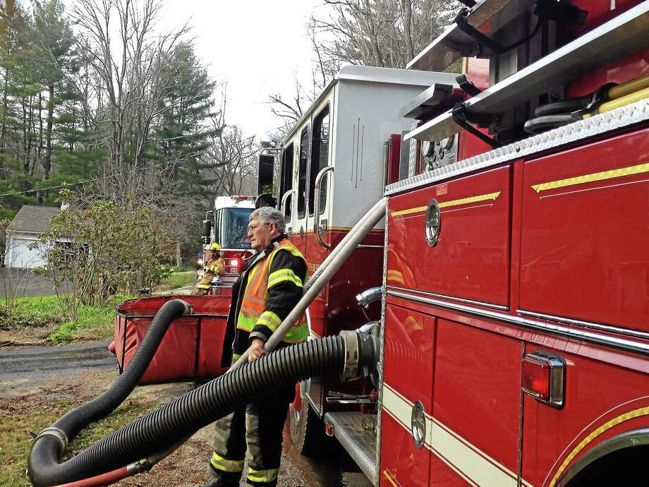 Jenny Golfin - Register Citizen Firefighters from Pine Meadow, New Hartford, Harwinton and Burlington fire departments  responded to a barn fire at at 573 Steele Road in New Hartford Monday afternoon, which was extinguished within 35 minutes. Photo: Journal Register Co.
