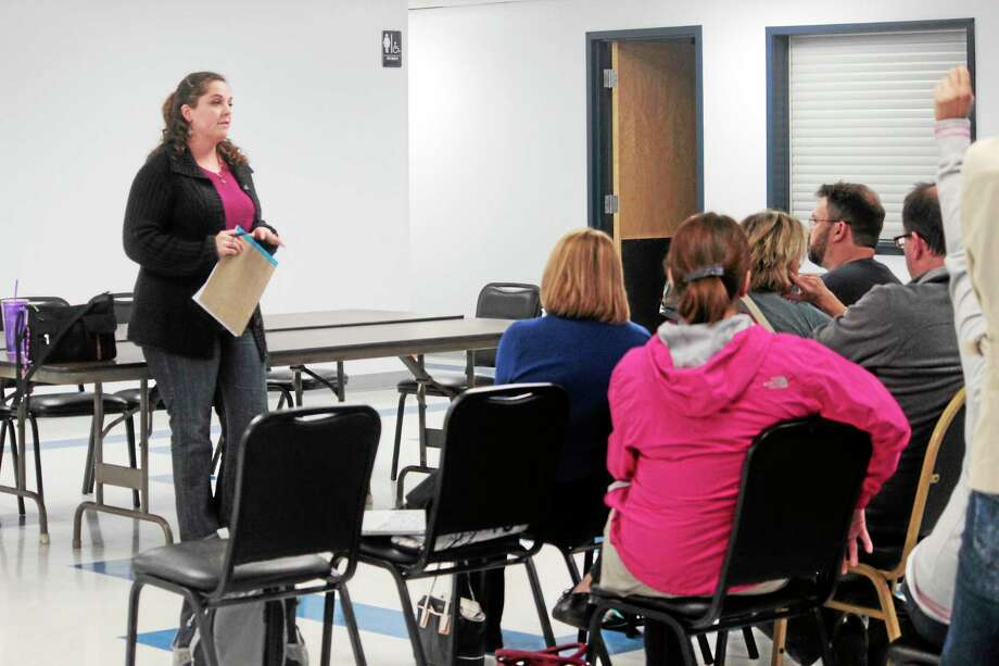Maureen Dobos gathered Litchfield parents to address the issue of the school leadership during a meeting at the Northfield Firehouse Monday. Photo: Shako Liu — The Register Citizen