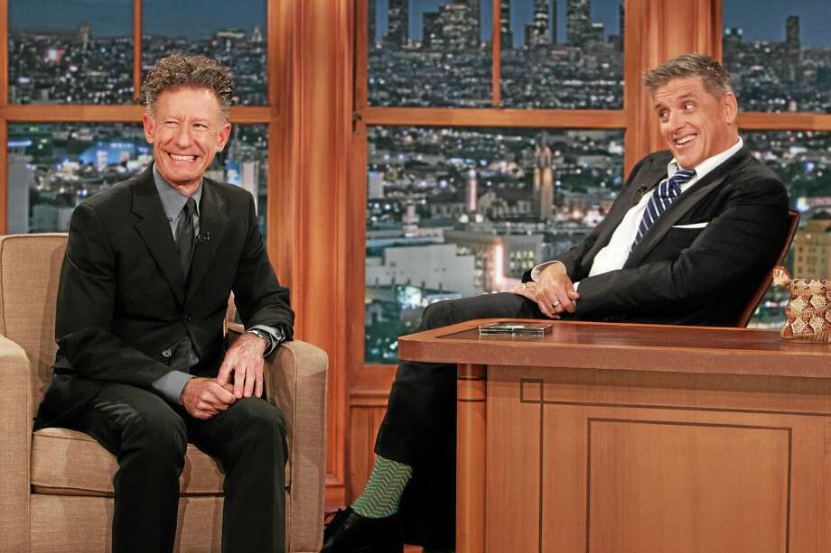 """This Wednesday, April 23, 2014 photo released by CBS shows Lyle Lovett, left, and Craig Ferguson on """"The Late Late Show with Craig Ferguson,"""" on the CBS Television Network. Ferguson says he is stepping down as host of the show this year. CBS said that Ferguson made the announcement to his studio audience Monday, April 28, 2014.  (AP Photo/CBS, Sonja Flemming) Photo: AP / CBS ENTERTAINMENT"""