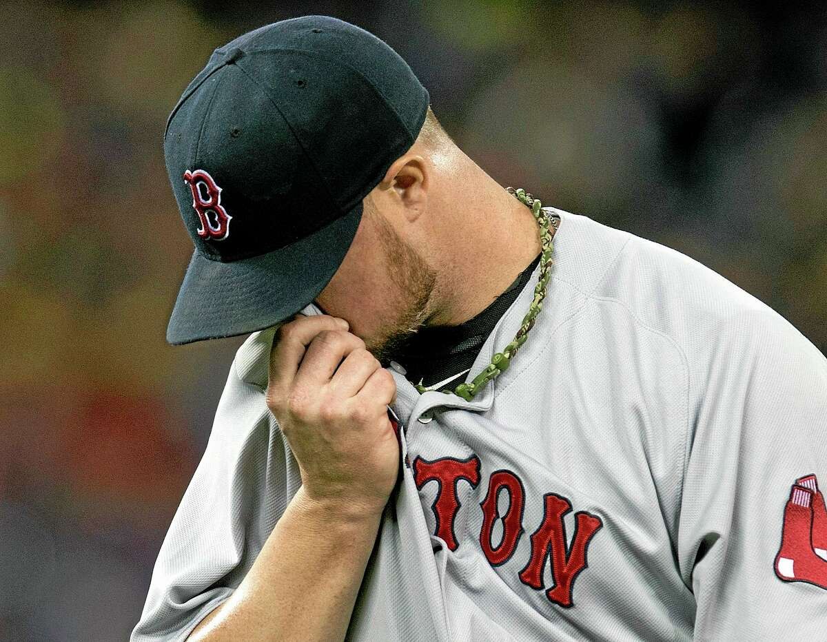 Red Sox starting pitcher Jon Lester walks off the field during the third inning against the Blue Jays in Toronto on Sunday.