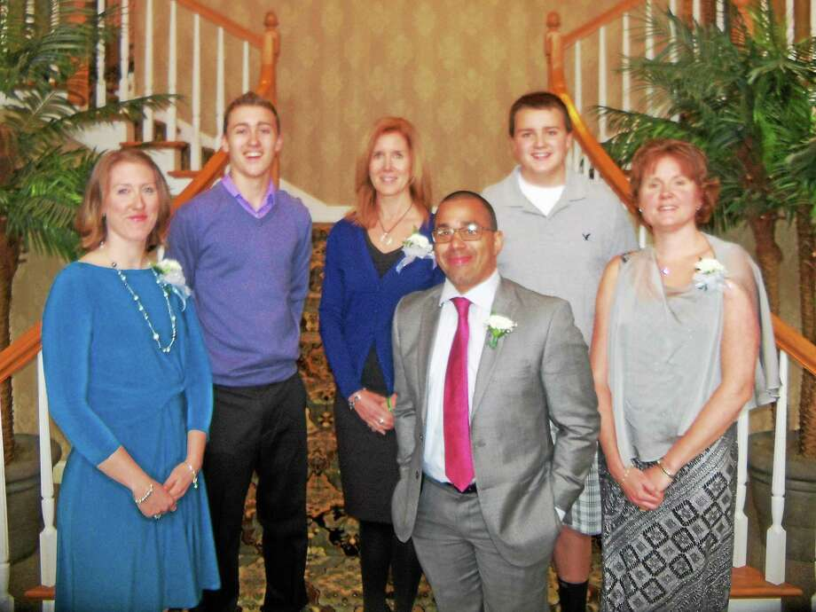 The Torrington High School Hall of Fame inducted four new members as its 18th class Sunday evening. Inductees are, front row, from left: Christine Strawson Gamari; Davie Lee Holliday; Tina Shanahan O'Marra. Back row, family members representing the late Tim Considine, from left: son Tim Jr.; wife Cheryl; and son Brian. Photo: Peter Wallace — Register Citizen