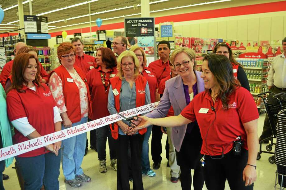 Mayor Elinor Carbone and store manager Andrea Ege cutting the ribbon to launch the store's grand opening. Photo: Ryan Flynn - Register Citizen