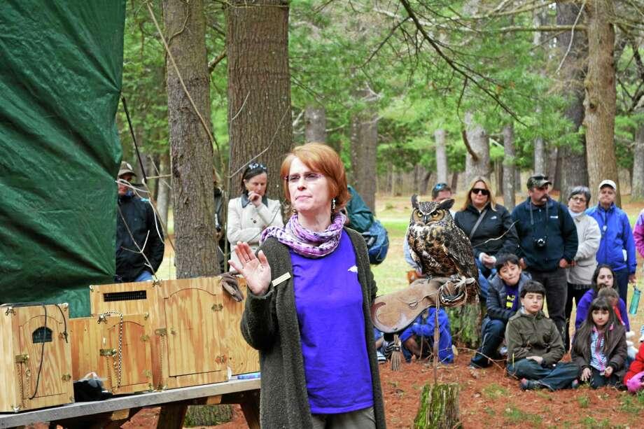 Christine Cummings-Secki addresses the crowd in Barkhamsted to discuss birds of prey. Photo: Ryan Flynn - Register Citizen