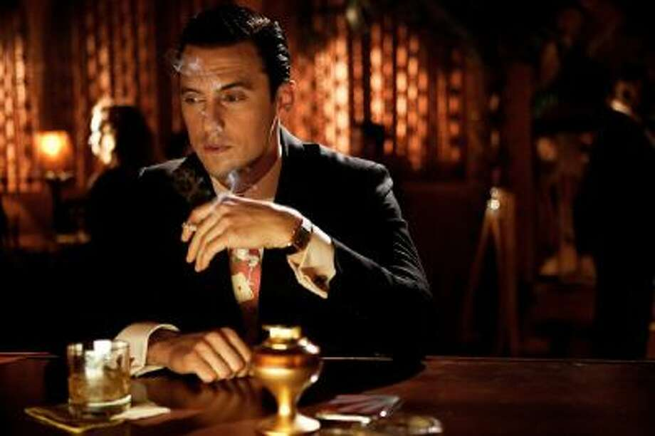 """This photo provided by TNT shows Milo Ventimiglia in a scene from the pilot episode, A Guy Walks Into A Bar"""" in the new TNT drama series, """"Mob City."""""""