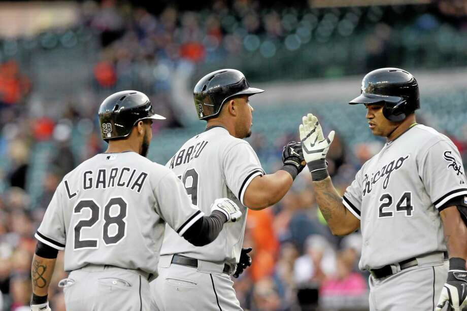 Chicago White Sox outfielder Dayan Viciedo (24) greets fellow Cuban Jose Abreu after his two-run homer against the Tigers on Wednesday in Detroit. Abreu is already a fantasy stud, but Viciedo deserves more respect than he's getting from fantasy owners. Photo: Carlos Osorio — The Associated Press File Photo  / AP