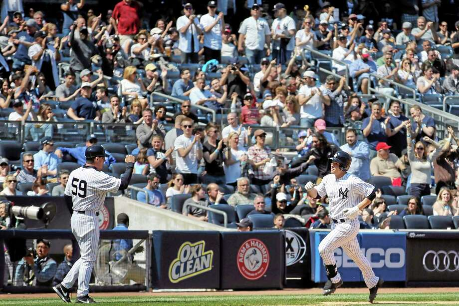 New York Yankees rookie catcher John Ryan Murphy rounds third base after hitting his first career home run in the fifth inning of Saturday's win over the Los Angeles Angels at Yankee Stadium. Photo: John Minchillo — The Associated Press  / FR170537 AP