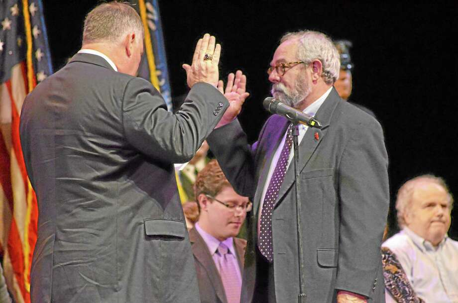 Paul Raider being sworn in as a member of the Torrington Board of Education by David Moraghan. Photo: John Berry—Register Citizen