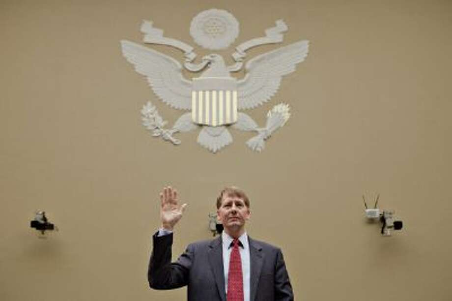 Richard Cordray, director of the Consumer Financial Protection Bureau, gets sworn in before testifying at a recent Senate hearing. The watchdog bureau has been busy its first two years. Photo: Bloomberg Via Getty Images / 2012 Bloomberg