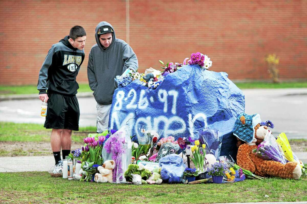 Mick Murray, left, 16, and Paul Bourdeau, 16, pay their respects Saturday at a memorial for their friend, Maren Sanchez, at Jonathan Law High School in Milford.