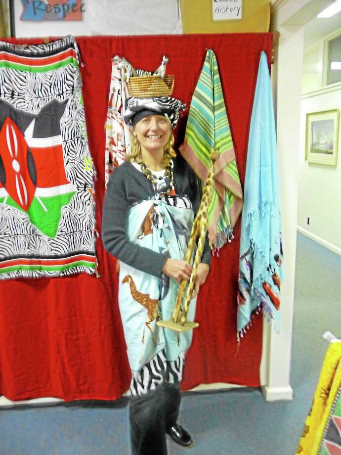 Submitted photo - Woodbury NCC Linda Leidel, an advocate for the Nambale Magnet School in western Kenya, modeling some of the jewelry that will also be available for sale at the December 10thth Open House at Woodbury's North Congregational Church.  Sale proceeds will be used to support the expansion of the Nambale Magnet School, which has as its major goal to educate and house western Kenyan orphans. Photo: Journal Register Co.