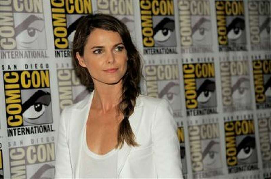 "In a Saturday, July 20, 2013 photo, Keri Russell attends the ""Dawn of the Planet of the Apes"" press line on Day 4 of Comic-Con International in San Diego, Calif. Photo: Chris Pizzello/Invision/AP / Invision"