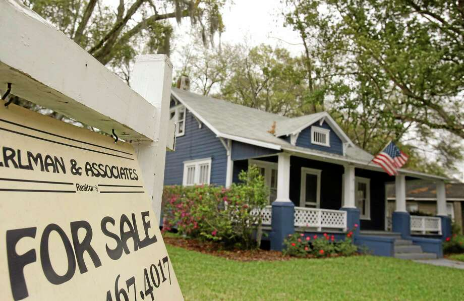 In this March 7 photo, a realty sign hangs in front of a home for sale in Orlando, Fla. Photo: John Raoux — The Associated Press  / AP