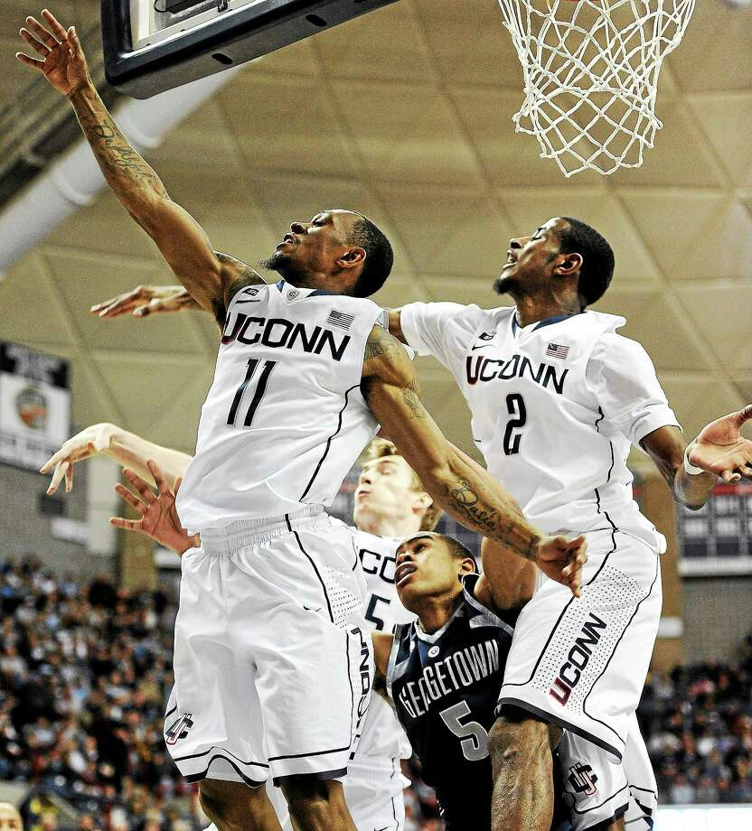Uconn's Ryan Boatright, left, will be back in Storrs next season, but  DeAndre Daniels, right, announced Friday that he will forego his senior season and declare for the NBA draft. Photo: Jessica Hill — The Associated Press File Photo  / FR125654 AP