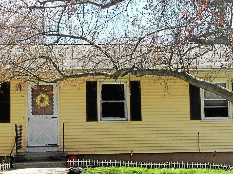 A blacked-out window is seen Friday at the Seymour house where a man is accused of holding his sister captive in squalor for years. Photo: Patricia Villers — New Haven Register