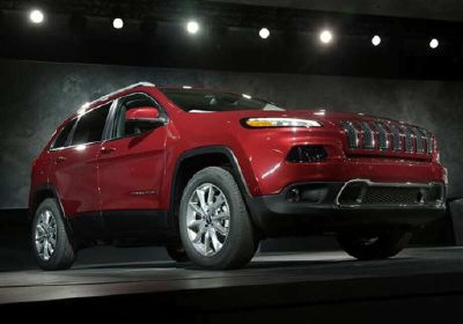 In this March 27, 2013 file photo, the 2014 Jeep Cherokee Limited is presented at the New York International Auto Show, in New York's Javits Center. Chrysler on Tuesday, Dec. 3, 2013 said its November U.S. sales rose a surprising 16 percent, a sign that the auto industry will beat strong numbers from a year ago. The company sold more than 10,000 Cherokees in the small crossover SUV?s first full month on the market. Photo: AP / AP