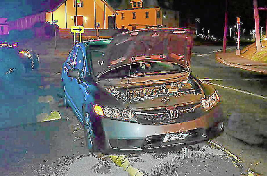 A car involved in a one-car accident on Torrington's Main Street Tuesday. Photo: Ryan Flynn—Register Citizen