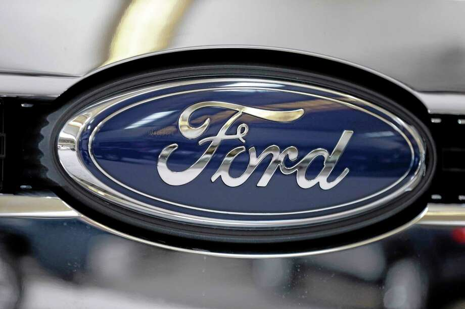 The Ford logo on the grill of a 2013 Ford F-350 truck. Photo: Gene J. Puskar — The Associated Press  / AP