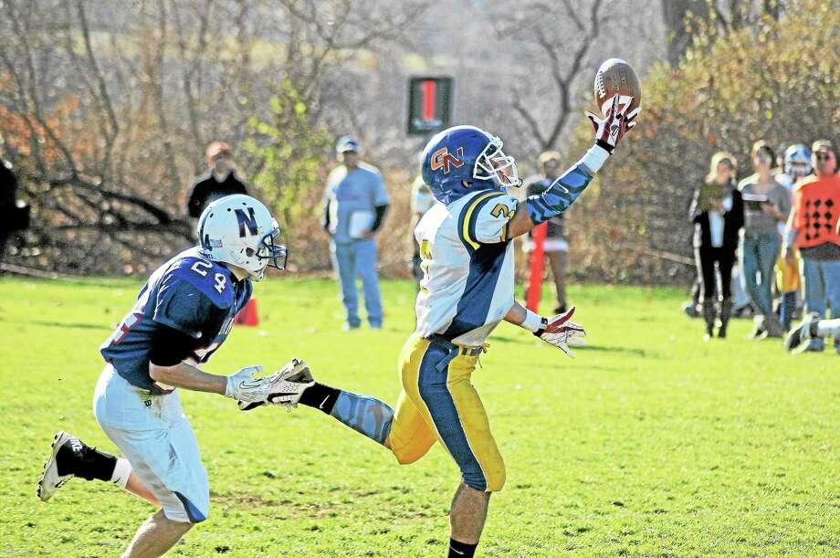 Sean Meenaghan - Register CitizenGilbert-Northwestern's Tony Ortiz makes a catch as Nonnewaug's Mark Violette defends. Photo: Journal Register Co.