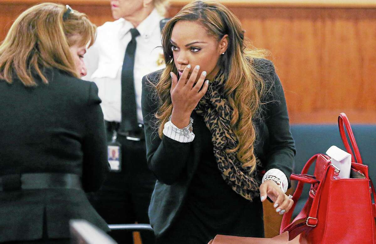 Shayanna Jenkins, girlfriend of former New England Patriots tight end Aaron Hernandez, talks with her defense attorney, Janice Bassil, left, at the conclusion of a pre-trial conference at Fall River Superior Court in Fall River, Mass., on Nov. 6.