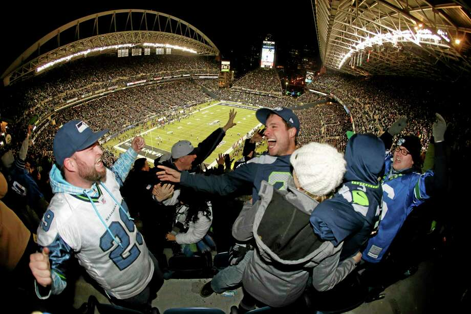 Seahawks fans were so loud and rocked the Seattle stadium so hard that seismic instruments registered small tremors on Monday night in a game against the New Orleans Saints. Photo: John Froschauer — The Associated Press  / FR74207 AP