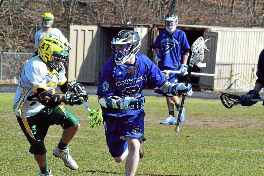 The Lewis Mills boys lacrosse team went 13-5 last season, earning a spot in the state tournament. The Spartans are 4-0 so far this season. Photo: Pete Paguaga — Register Citizen