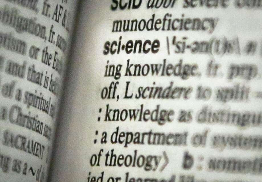 """This Monday, Dec. 2, 2013 photo shows the word """"science"""" on a page of a Merriam-Webster dictionary, in New York. """"Science"""" is the publisher's word of the year. (AP Photo/Bebeto Matthews) Photo: AP / AP"""