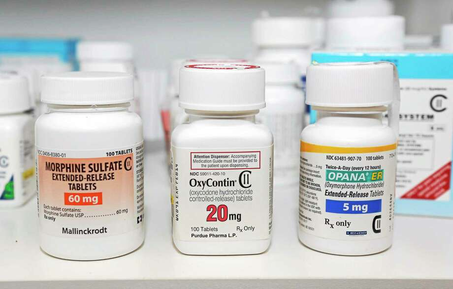 In this photo taken Friday, Jan. 18, 2013, prescription Schedule 2 narcotics Morphine Sulfate, OxyContin and Opana are displayed for a photograph in Carmichael, Calif. Photo: Rich Pedroncelli — The Associated Press  / AP2013