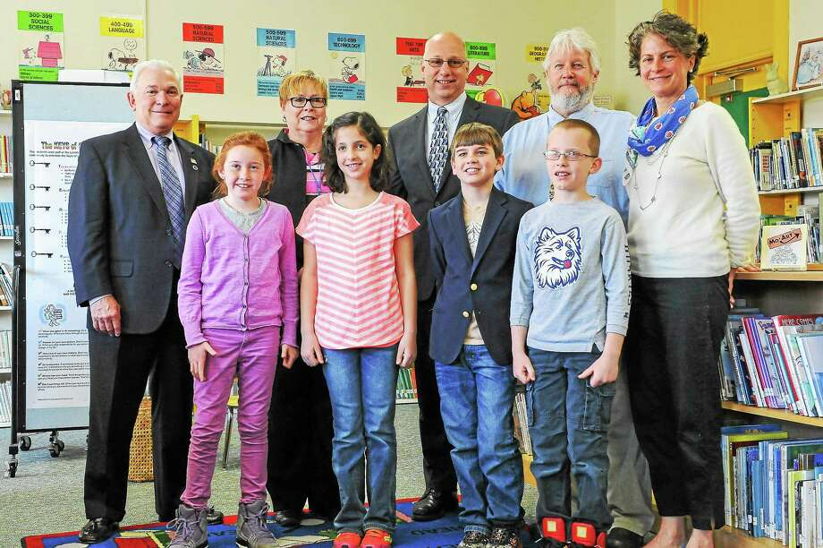 From left to right: Litchfield First Selectman Leo Paul, Superintendent Deborah Wheeler, state Sen. Clark Chapin, state Rep. Craig Miner and Joanne Moore, Media Specialist & Students. Photo: Contributed Photo