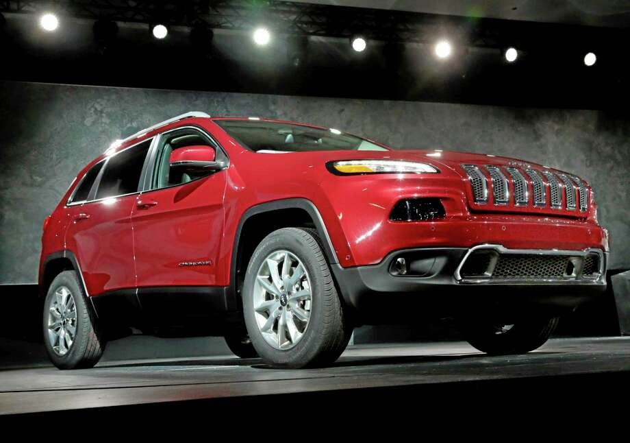 FILE - In this March 27, 2013 file photo, the 2014 Jeep Cherokee Limited is presented at the New York International Auto Show, in New York's Javits Center. Chrysler on Tuesday, Dec. 3, 2013 said its November U.S. sales rose a surprising 16 percent, a sign that the auto industry will beat strong numbers from a year ago. The company sold more than 10,000 Cherokees in the small crossover SUV's first full month on the market. (AP Photo/Richard Drew, File) Photo: AP / AP
