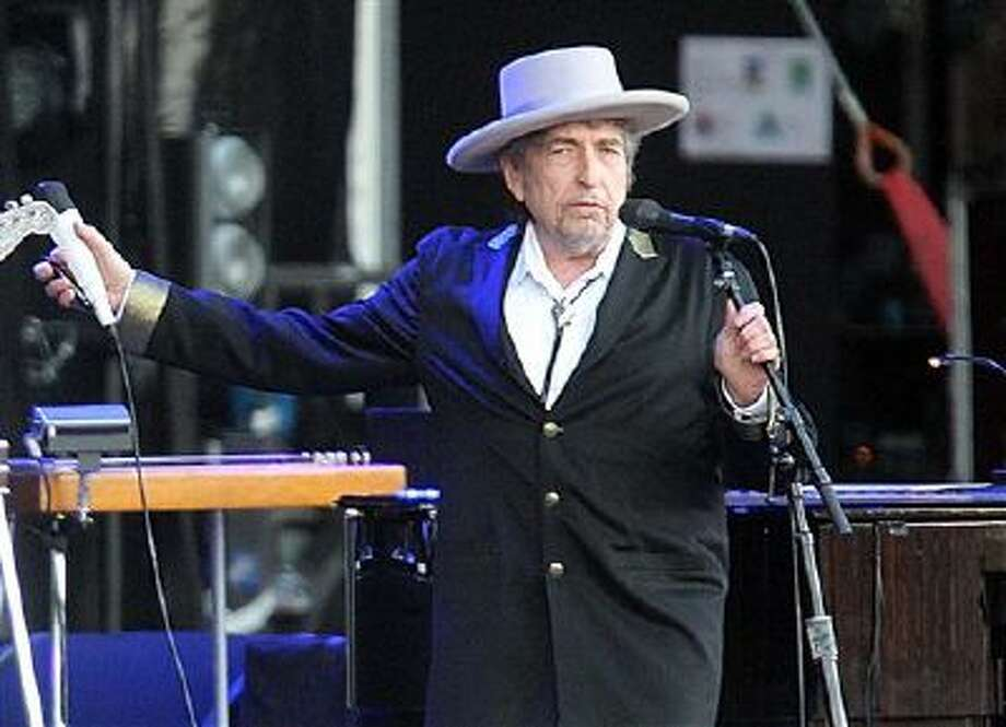 "This July 22, 2012 file photo shows U.S. singer-songwriter Bob Dylan performing on stage at ""Les Vieilles Charrues"" Festival in Carhaix, western France. Photo: AP / AP"