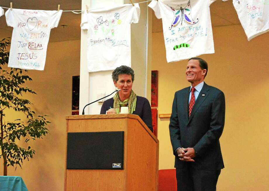 Barbara Spiegel, Executive Director of the Susan B. Anthony Project and Senator Richard Blumenthal address those in attendance at the vigil. Photo: Ryan Flynn — Register Citizen