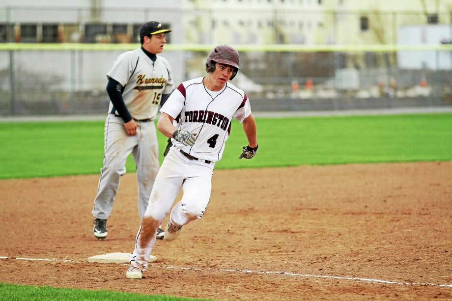 Torrington's John McCarthy rounds third and heads toward home on Mitch Zagodnikís two run triple in the Red Raiders' 9-2 victory over Kennedy. Photo: Marianne Killackey — Special To Register Citizen  / 2013