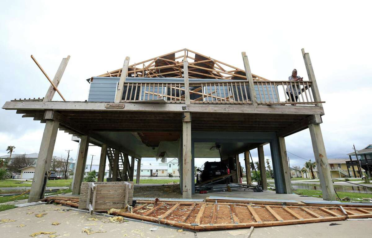Janie Newcomer of San Antonio stands on the deck of her severely damaged retirement home in Rockport, near where then-Hurricane Harvey made landfall. Rockport was among the hardest-hit communities.