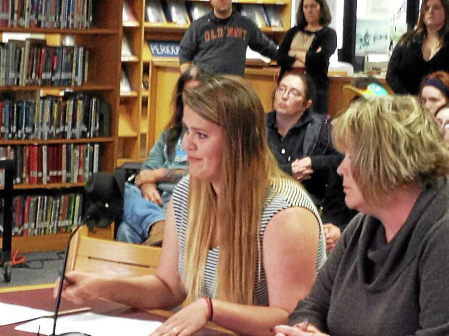 Mikayla Perlotto, an 18-year-old senior at Torrington High School, pleads with the Board of Education to allow her to attend prom with her 22-year-old boyfriend. The school has so far maintained that no one older than 20 may attend the function. Photo: Isaac Avilucea — Register Citizen