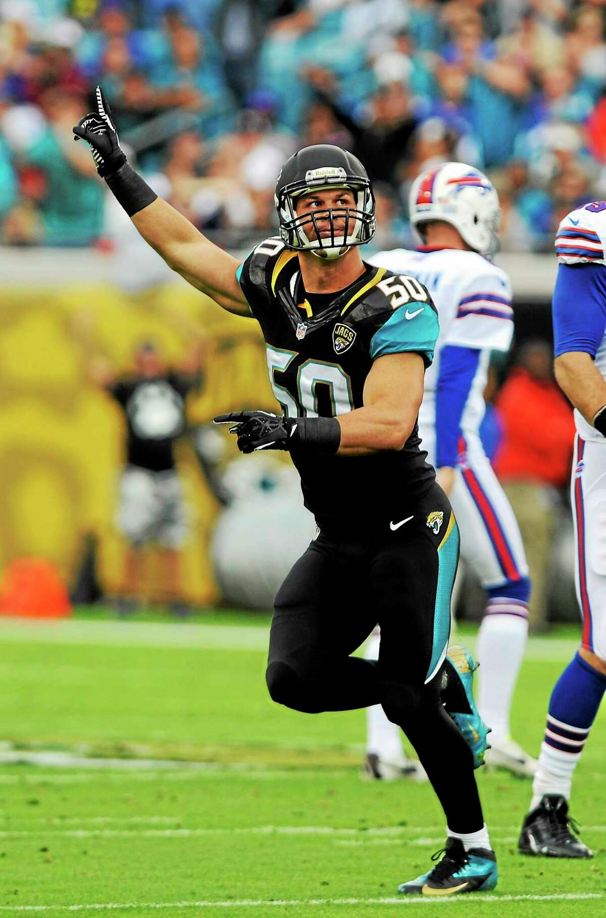 Jaguars outside linebacker Russell Allen (50) celebrates a missed field goal by the Buffalo Bills during the final game of his career on Dec. 15, 2013, in Jacksonville, Fla. Allen suffered a stroke during the game and is retiring.