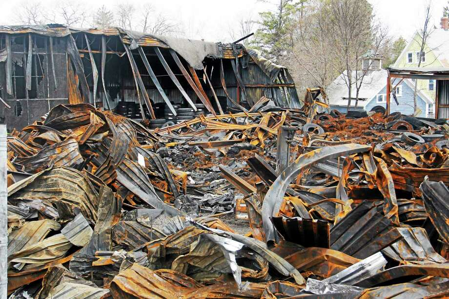 The remnants of the Toce Brother tire warehouse on Albert Street as seen on April 22, 2014, in Torrington. The city's fire marshal ruled the cause of the fire as undetermined. Photo: Esteban L. Hernandez — Register Citizen