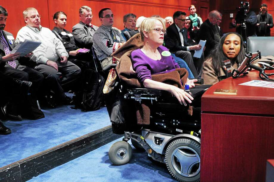 (Arnold Gold-New Haven Register)  Sara Myers of Kent, Connecticut, testifies during a public hearing before the Public Health Committee concerning House Bill 5326, an Act Concerning Compassionate Aid in Dying For Terminally Ill Patients, at the Legislative Office Building in Hartford on 3/17/2014.  Myers has ALS and is in favor of the bill. Photo: Journal Register Co.