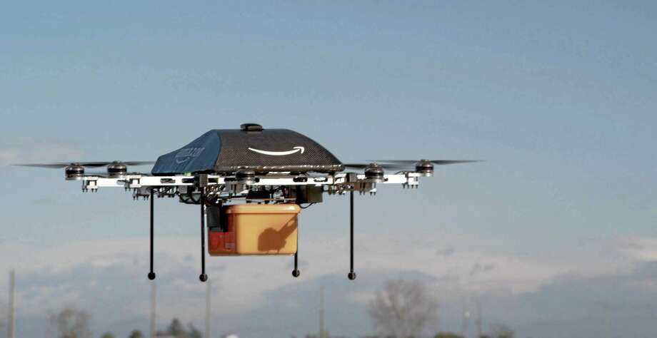 This undated image provided by Amazon.com shows the so-called Prime Air unmanned aircraft project that Amazon is working on in its research and development labs. Amazon says it will take years to advance the technology and for the Federal Aviation Administration to create the necessary rules and regulations, but CEO Jeff Bezos said Sunday Dec. 1, 2013,  there's no reason Drones can't help get goods to customers in 30 minutes or less. (AP Photo/Amazon) Photo: AP / Amazon