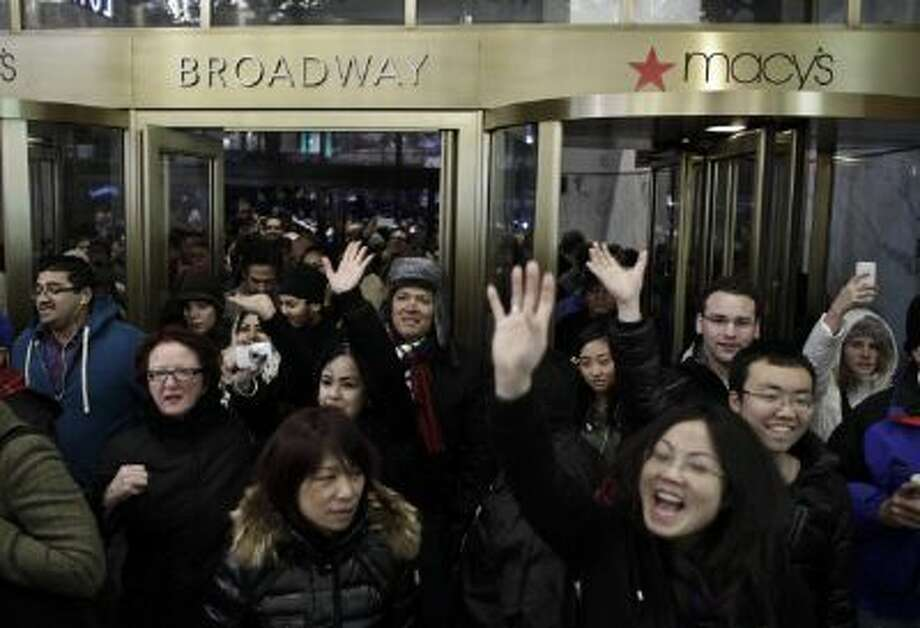 People enter Macy's Herald Square as the store opens its doors at 8 pm Thanksgiving day on November 28, 2013 in New York City. Black Friday shopping began early again this year with most major retailers opening their doors on Thanksgiving day. Photo: Getty Images / 2013 Getty Images
