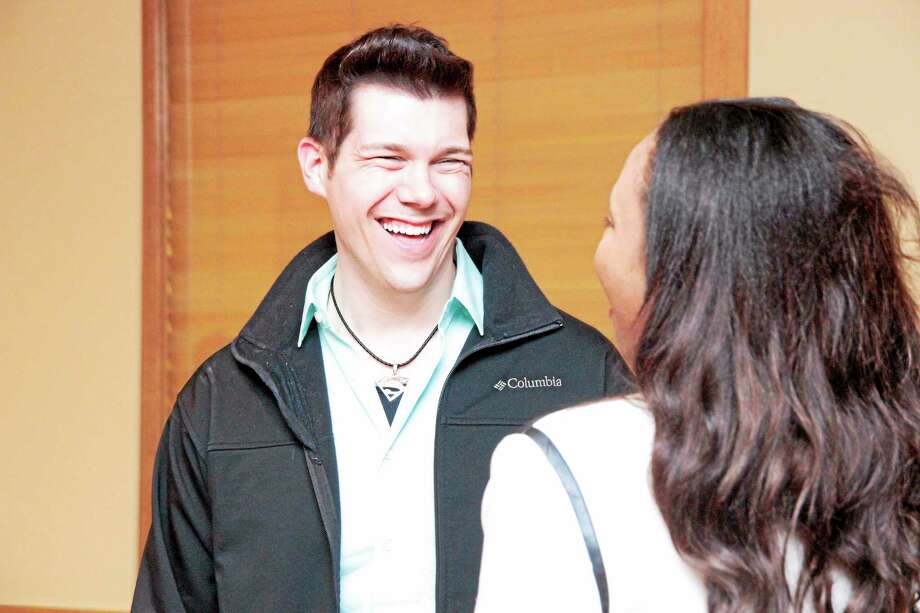 Tyler Green was talking to his business partner Liz Slaughter at the Finale party. Photo: Shako Liu — The Register Citizen