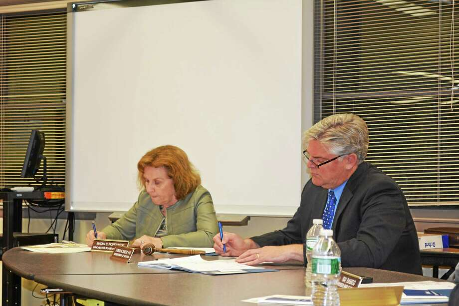 Board of Education Chair Susan Hoffnagle (left) and resigning Superintendent Thomas Danehy (right) discussed Tuesday night with the rest of the board how the hiring process for his replacement will proceed. Photo: Ryan Flynn — Register Citizen