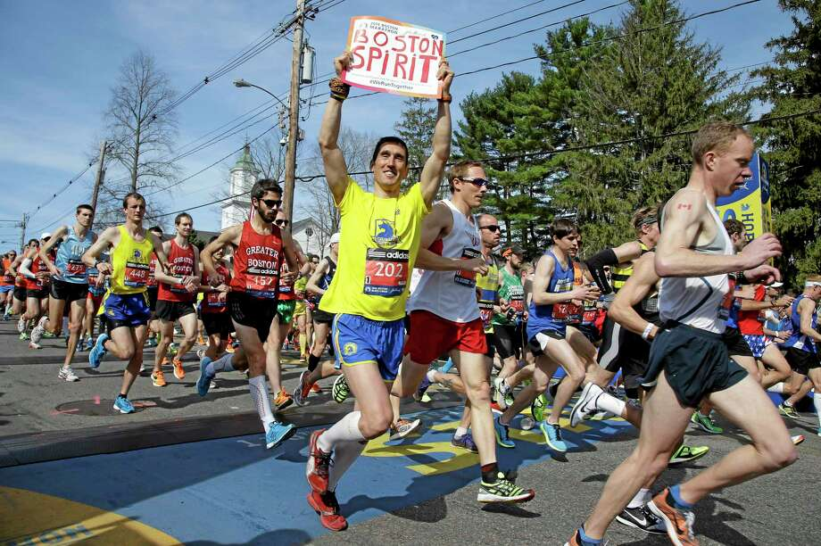 Runners in the first wave of 9,000 cross the start line of the 118th Boston Marathon Monday, April 21, 2014 in Hopkinton, Mass.  (AP Photo/Stephan Savoia) Photo: AP / AP